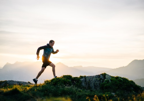 Man Running a Mountain after Meeting with a Life Coach in Peoria IL